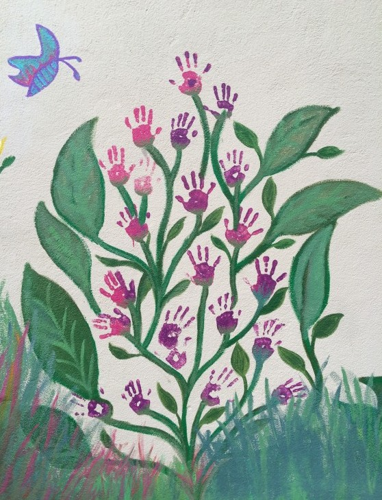 butterfly and hand flower mural detail