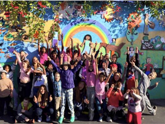Oxford kids in front of rainbow mural