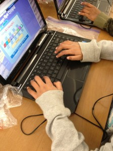 kid hands on laptops